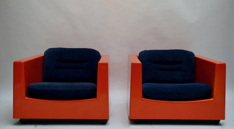 Two lounge armchairs on casters by French Designer Roger Tallon. The shells are made from fibreglass.