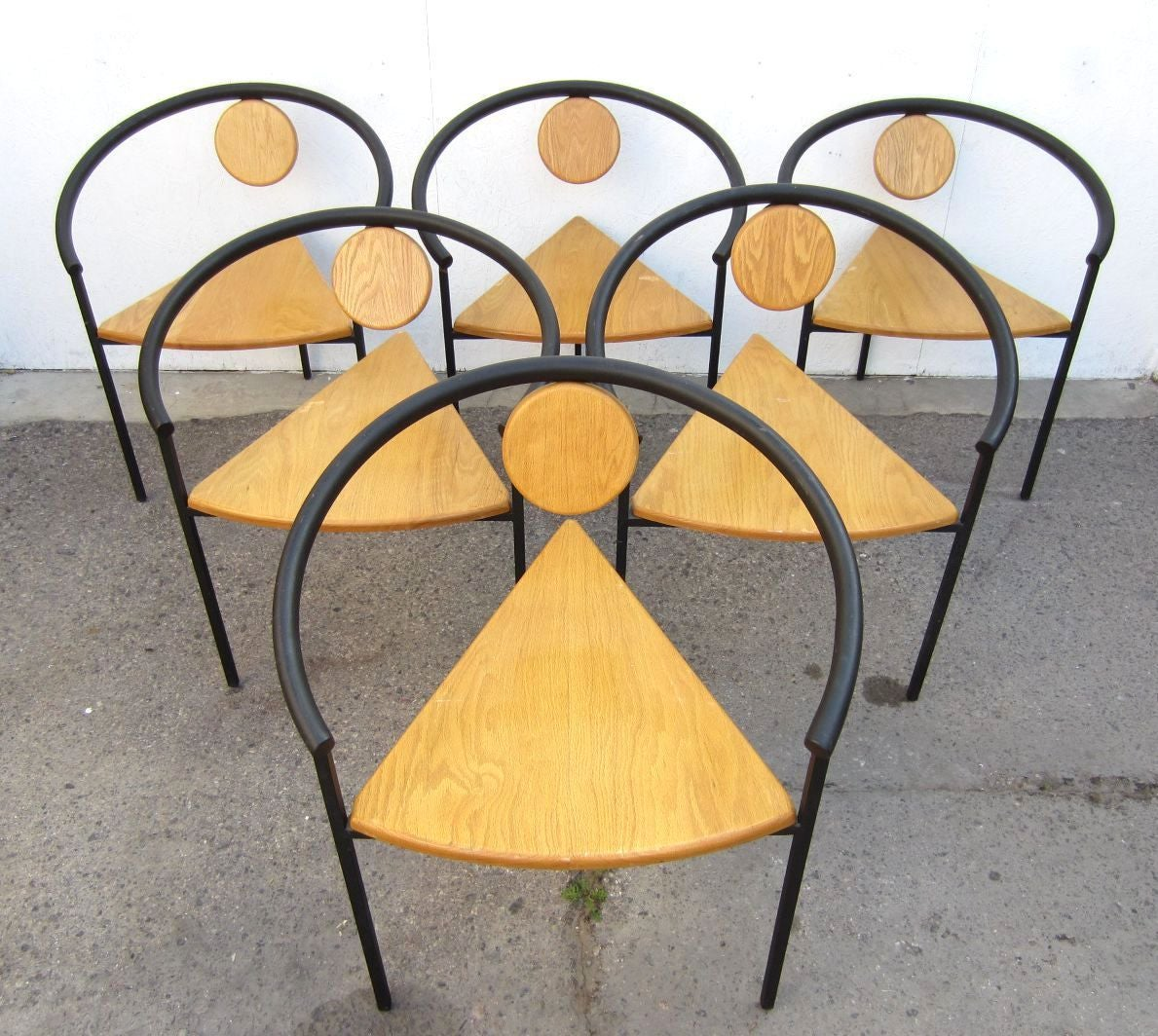 Six memphis post modern dining or arm chairs in the style of michele de lucchi for