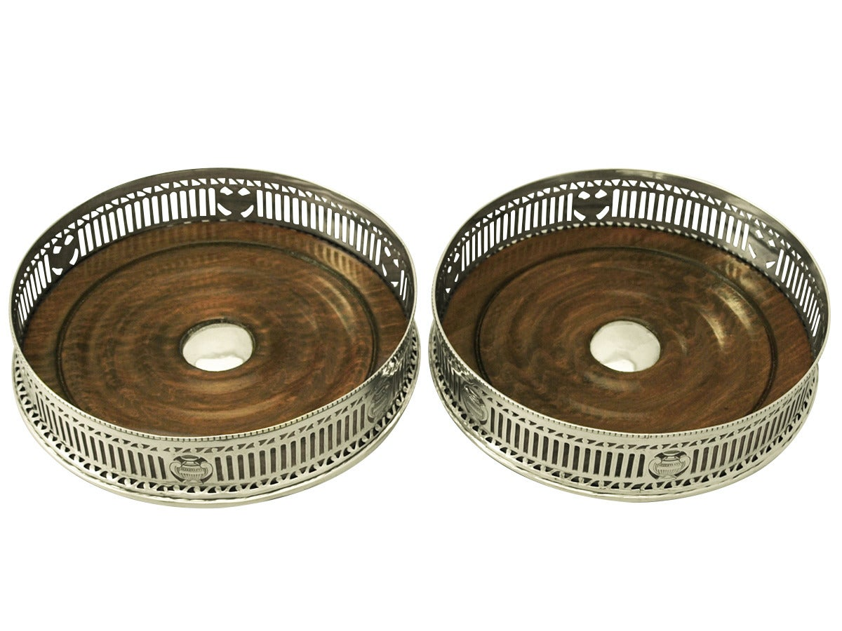 A very good and impressive pair of antique George V English sterling silver and mahogany wood coasters; an addition to our range of wine and drink related silverware
