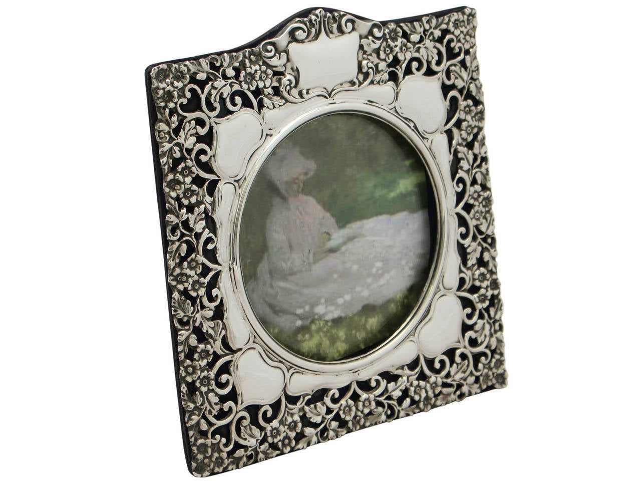 A fine and impressive antique Edwardian English sterling silver photograph frame; an addition to our ornamental silverware collection.