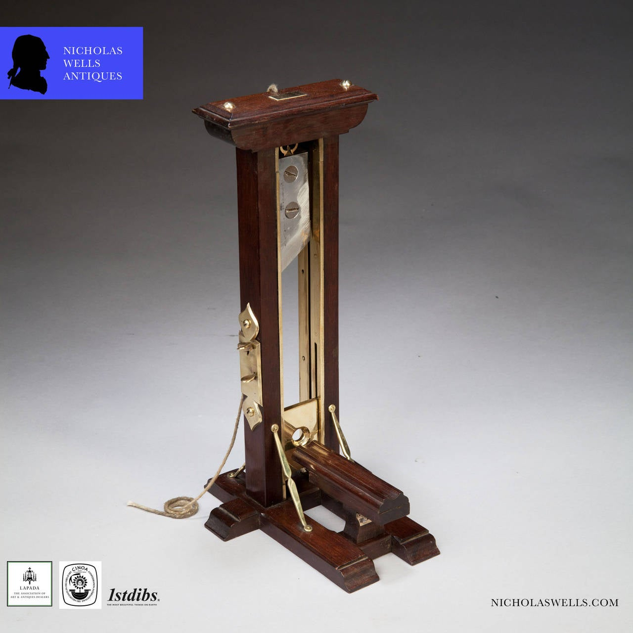 An Ile du Diable prisoner of war mahogany and brass cigar cutter made in the form of a guillotine.