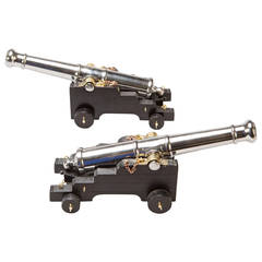Pair Of Polished Steel 9 Pound Model Cannon