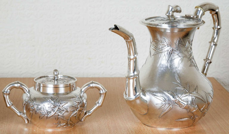 Chinese silver tea and coffee service made by Wang Hing, circa 1895. Each piece is embossed with bamboo against a hammered background, and the handles, finials and spouts are all formed as sections of bamboo. The total weight is 1700gms