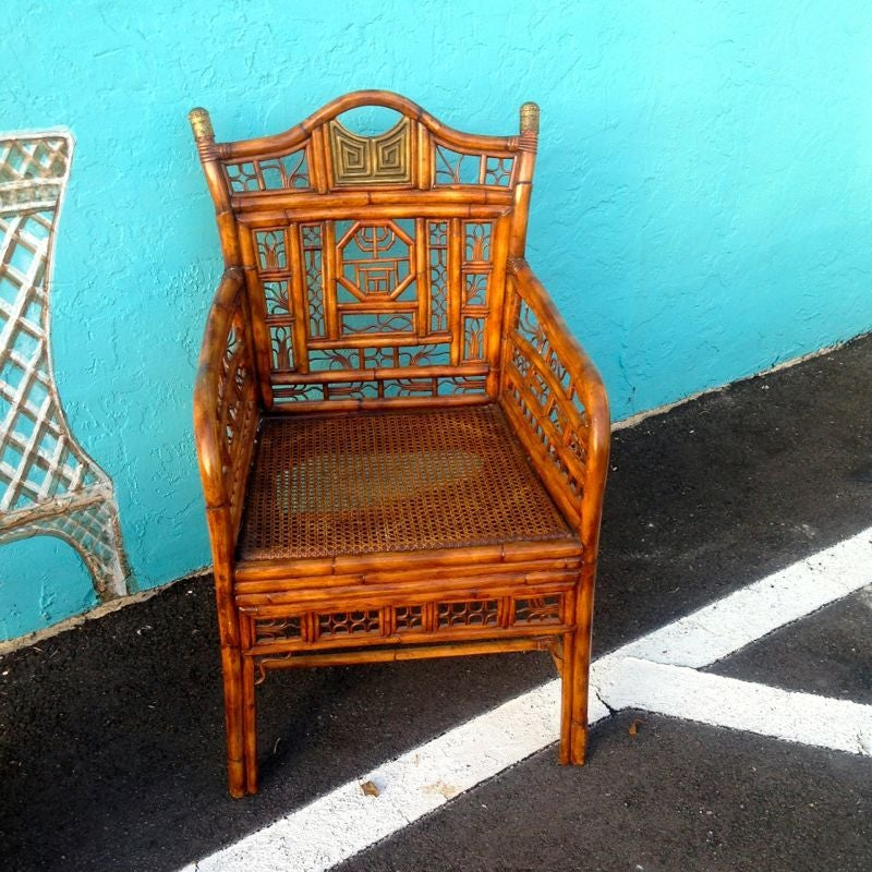 """""""Brighton"""" bamboo armchair. An elaborate vintage bamboo armchair with brass appointed back rest and caps. Loose cushion over caned seat."""