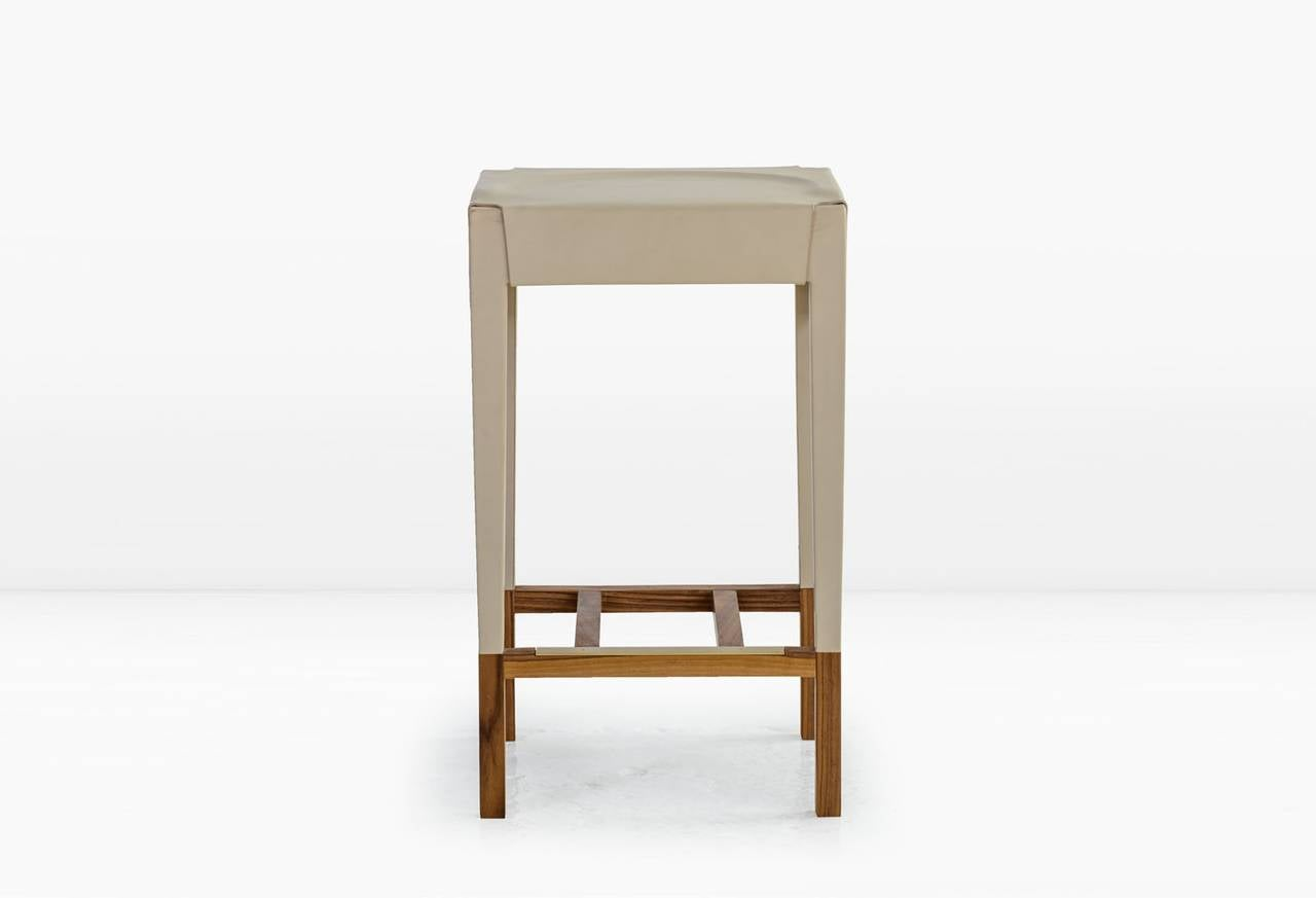 Modern Cassius Barstool with Cream Molded Leather, Solid Walnut Frame, Brass Footrest For Sale