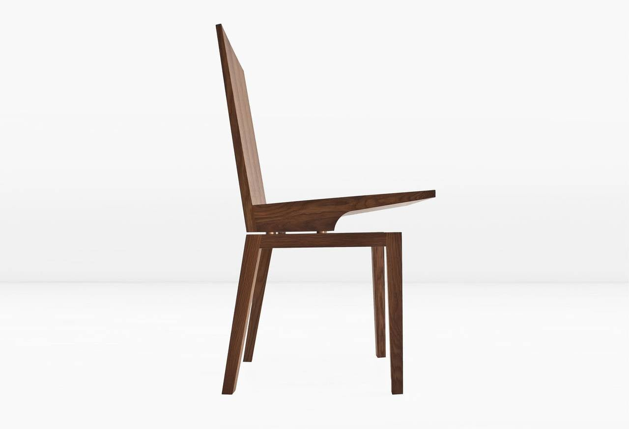 The corbett chair is fabricated of solid, rift cut wood. Bronze standoffs allow the seat to visually float above the base. Shown in quartered fumed white oak. Also available in American black walnut. Designed and built by KGBL. Made to order.