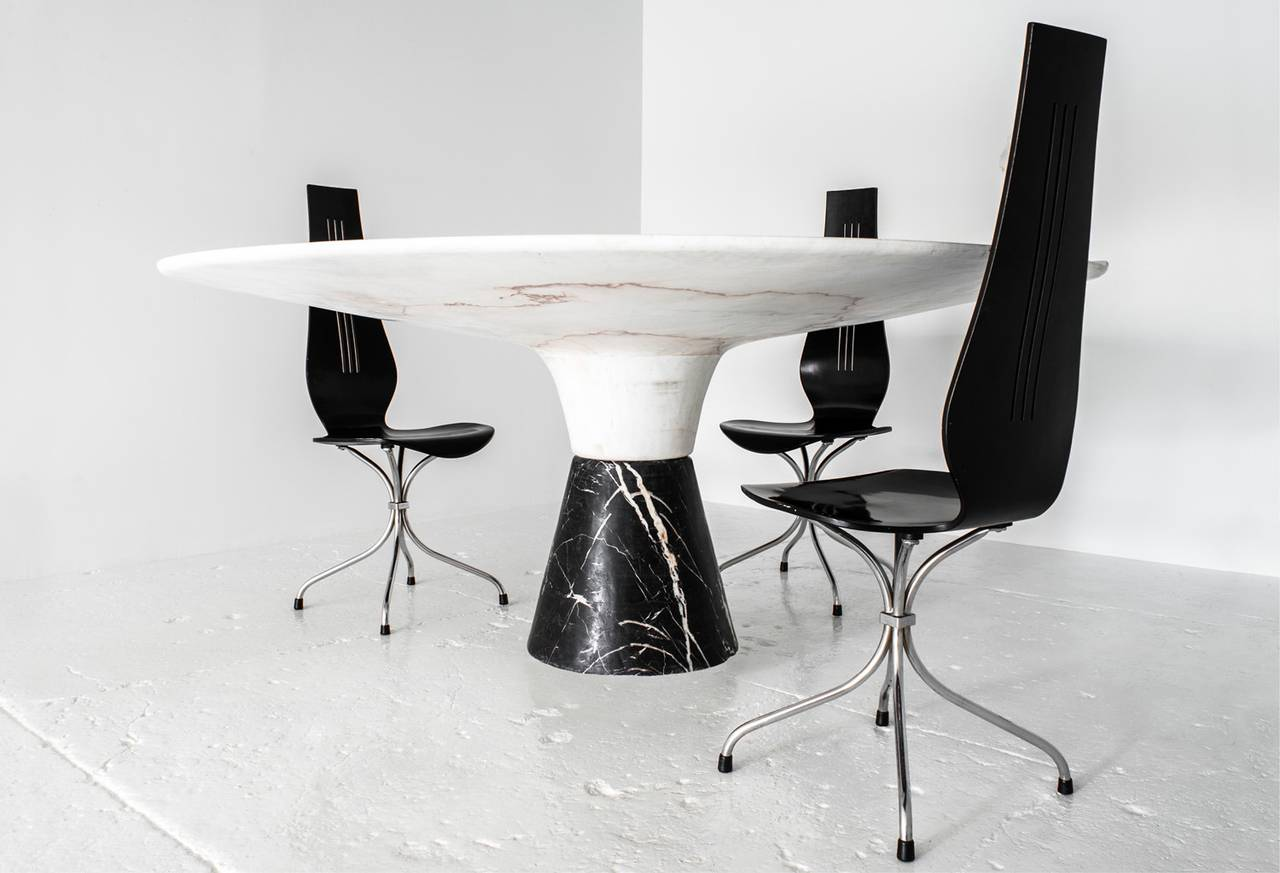 demarco dining table with solid hewn white marble top and