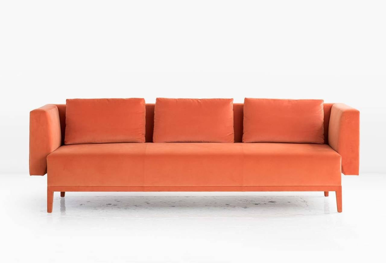The Liston sofa was conceived and executed as a fully upholstered piece, including the legs, to give it a unity of form. Arms and back float away from the seat. The quilted exterior of the Liston further refines this sculpted sofa and offers