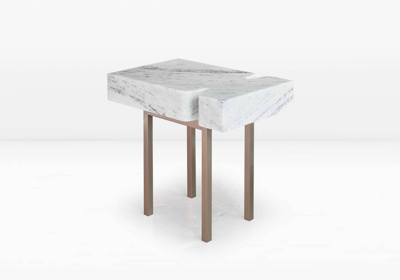 The Terranova side table comprises the obverse of its companion piece, the Terranova coffee table, allowing the delicate base to feature more prominently. Shown with a statuary marble top and solid silicon bronze base. Options include a white marble