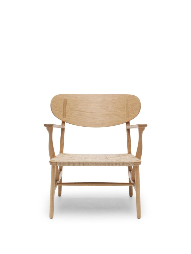 For Sale: Brown (Oak Oil) CH22 Lounge Chair in Wood with Natural Papercord Seat by Hans J. Wegner
