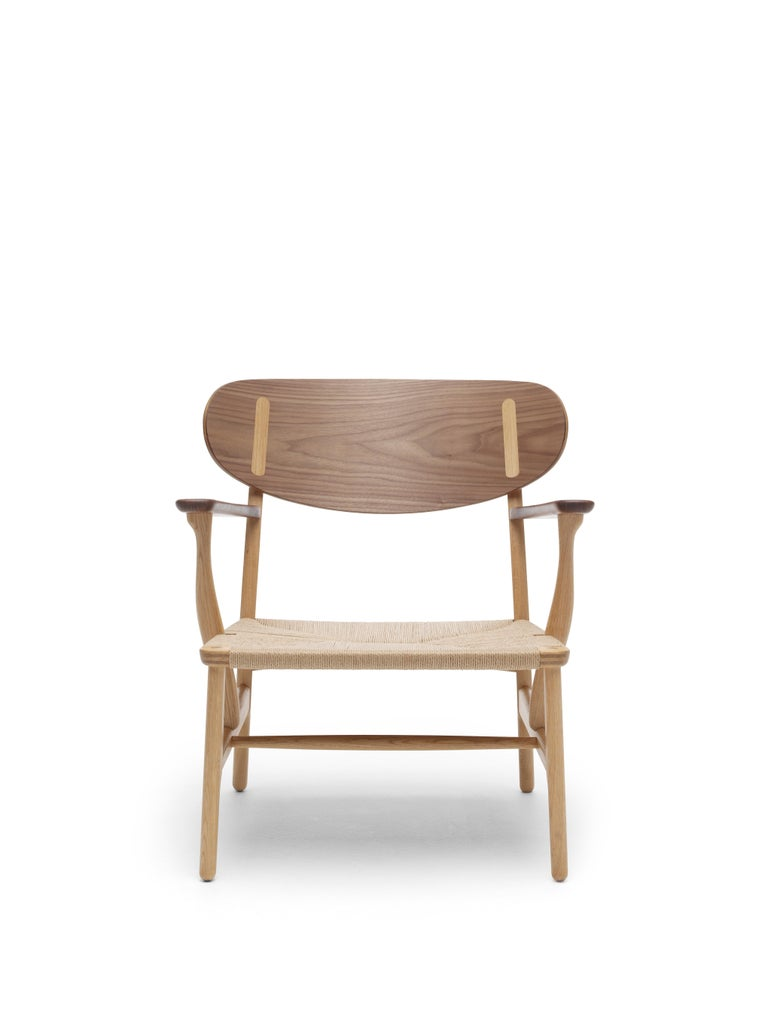 For Sale: Brown (Oak/Walnut) CH22 Lounge Chair in Wood with Natural Papercord Seat by Hans J. Wegner