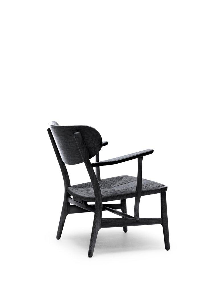 For Sale: Black (Oak Painted blacks9000-N) CH22 Lounge Chair in Wood with Black Papercord Seat by Hans J. Wegner 2