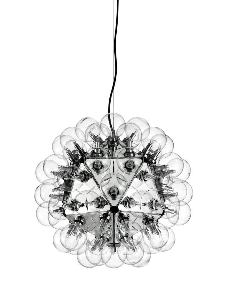 Based on the original Taraxacum created in 1960, the Taraxacum 88 reflects the iconic design's 1988 update and includes a mixture of deep incandescent lighting and cool, polished aluminum triangles.  Designed by master Achille Castiglioni, this