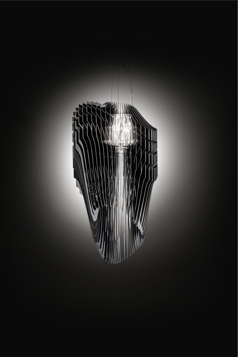Zaha Hadid's visionary, fluid, and dynamic luminous architectural objects bring the designer's revolutionary and iconic semantics to any domestic or public space, inspiring harmony between beings and atmospheres. Avia brings the grandeur of