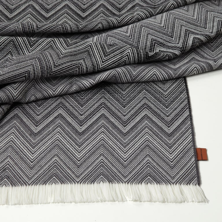 Missoni Home iconic chevron throw with a tonal ombre design. All Missoni Home products are custom made to order with the highest quality materials. Perfect for adding an elegant touch to any bedroom or living room.  Composition: 100% Wool. Care: