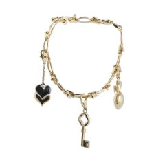 Louis Vuitton Idylle Blossom 18 Karat Gold Diamond and Peridot Charm Bracelet