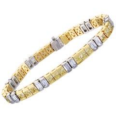18 Karat Gold and Platinum White Emerald Cut and Yellow Princess Cut Diamond T