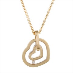 Chopard Happy Spirit 18 Karat Gold Floating Diamond Heart Pendant Necklace