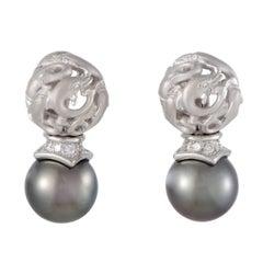 18 Karat White Gold Diamond and Black Pearl Dolphin Earrings