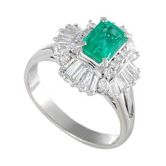 Platinum Round and Tapered Baguette Diamonds and Emerald Oval Ring
