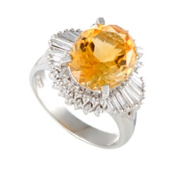 Platinum Round and Tapered Baguette Diamonds and Citrine Oval Ring