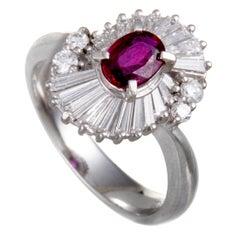 Platinum Round and Tapered Baguette Diamonds and Ruby Oval Ring
