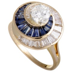 18 Karat Yellow Gold and Platinum Central Diamond Baguettes Sapphire Swirl Ring