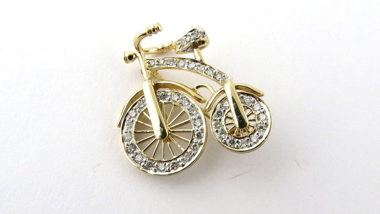 Vintage 14K Yellow Gold 3D Big Wheel Bicycle with Diamond Spinning Wheels   23 mm x 25 mm 42 diamonds - approx 1 ct total diamond weight VS clarity diamonds -white with lots of sparkle 3.45 dwt 5.4 g   Both wheels spin Beautiful well made piece