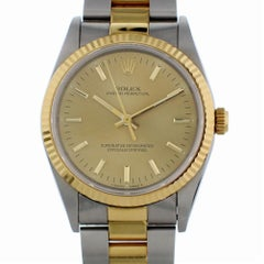 Certified Rolex Oyster Perpetual 14233 with Band and Gold Dial