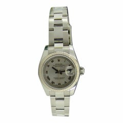 Rolex Lady 18kt White Gold and Stainless Silver Roman DateJust 179174