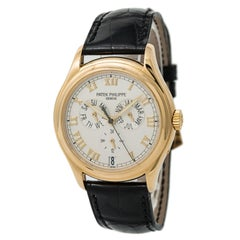 Certified: Patek Philippe Annual Calendar Mens Automatic Watch Cream Dial 18K YG