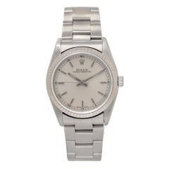 Certified Rolex Oyster Perpetual with Band, SS Bezel and Silver Dial