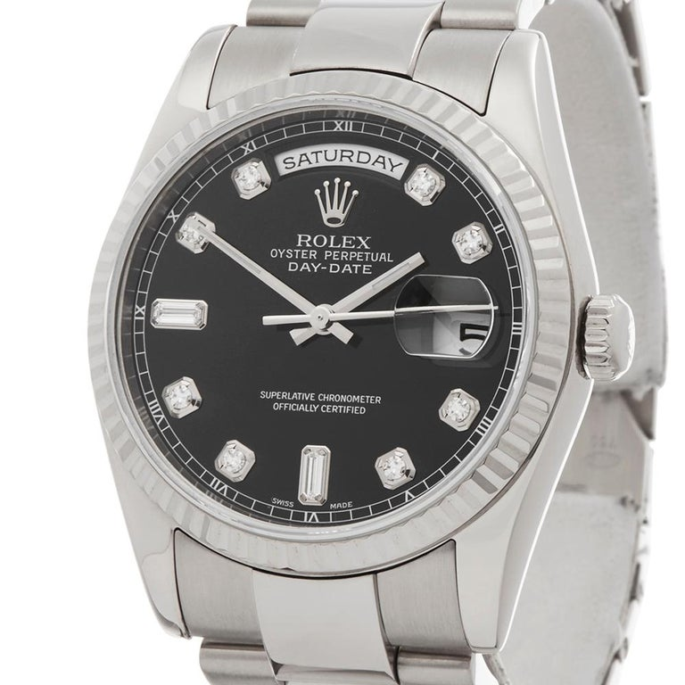 Contemporary 2000 Rolex Day-Date White Gold 118239 Wristwatch  *  *Complete with: Box Only dated 2000  *Case Size: 36mm  *Strap: 18K White Gold Oyster  *Age: 2000  *Strap length: Adjustable up to 18cm. Please note we can order spare links and
