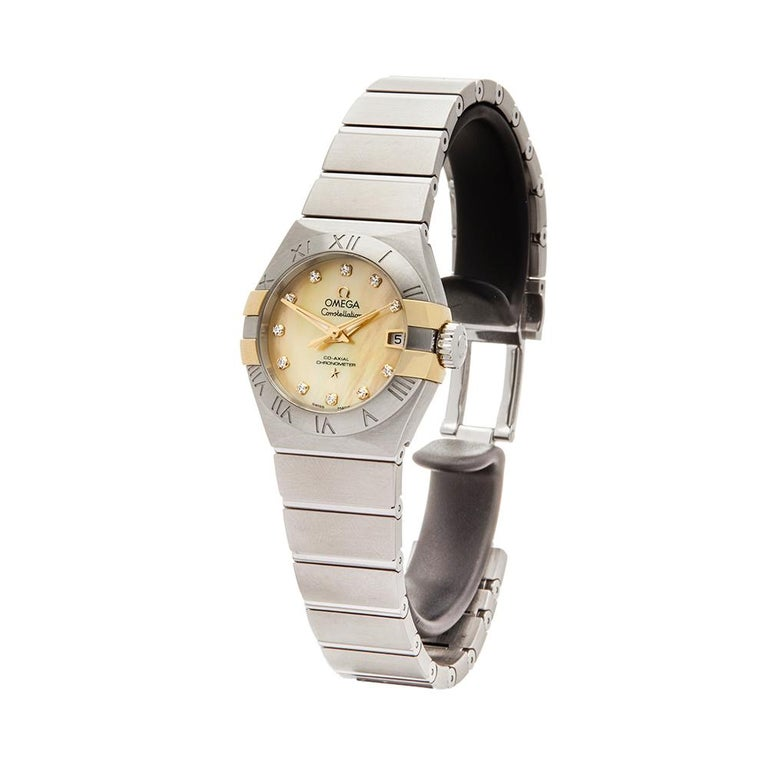 Contemporary 2017 Omega Constellation Steel & Yellow Gold 123.20.27.20.57.003 Wristwatch  *  *Complete with: Box, Manuals & Guarantee dated 2017  *Case Size: 27mm  *Strap: Stainless Steel  *Age: 2017    **  Condition: Item is in unworn or unused