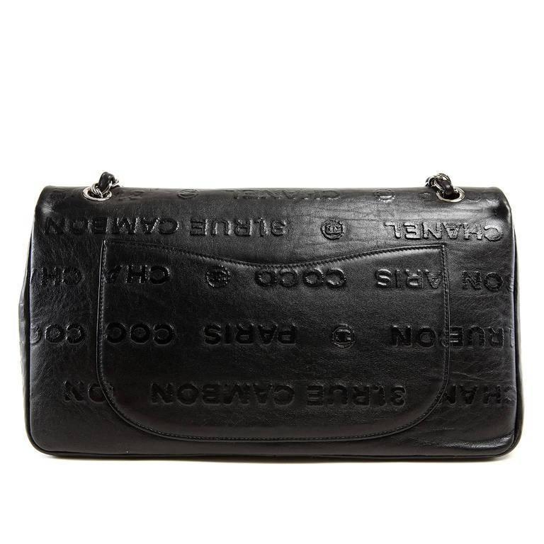Chanel Black Leather Rue Cambon Double Flap Bag- PRISTINE; Rare Embossed in black on black with iconic Chanel words, this piece is a must have for collectors. Black leather double flap style shoulder bag is covered in raised block lettering.