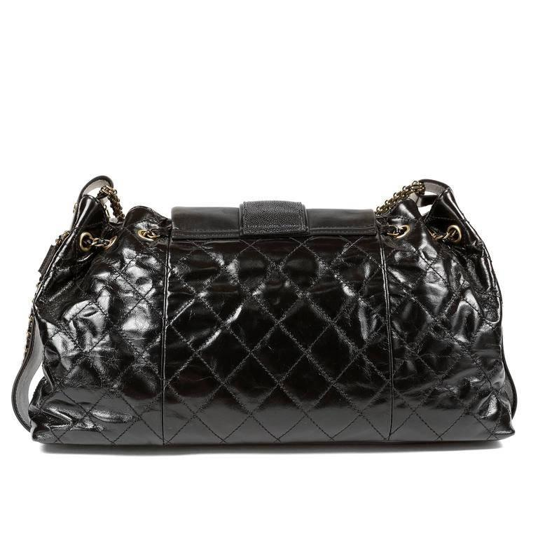 Chanel Black Calfskin and Stingray Jumbo Accordion Bag- Pristine Condition, appearing never carried. From the 2012 Bindi Collection, this piece features stingray accents on the flap and drawstring loops. Black glazed calfskin has a somewhat