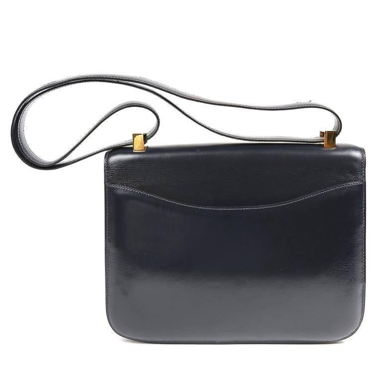Hermes Navy Box Calf Constance- EXCELLENT The Constance is considered truly classic and highly collectible. The Constance has simple clean lines with a style that suggests an equestrian saddle bag. Worn over the shoulder or cross body, it is quite