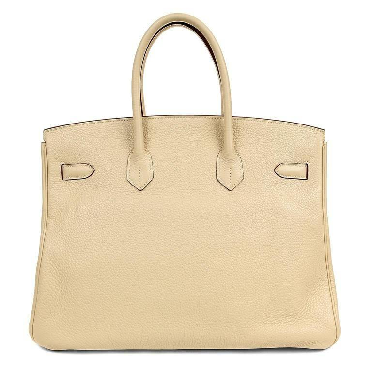 Hermes Parchemin Togo 35 cm Birkin Bag- PRISTINE; appears never carried.  Waitlists exceeding a year are commonplace for the intensely coveted Birkin. Each piece is hand sewn by skilled artisans and represents the epitome of fashion luxury.