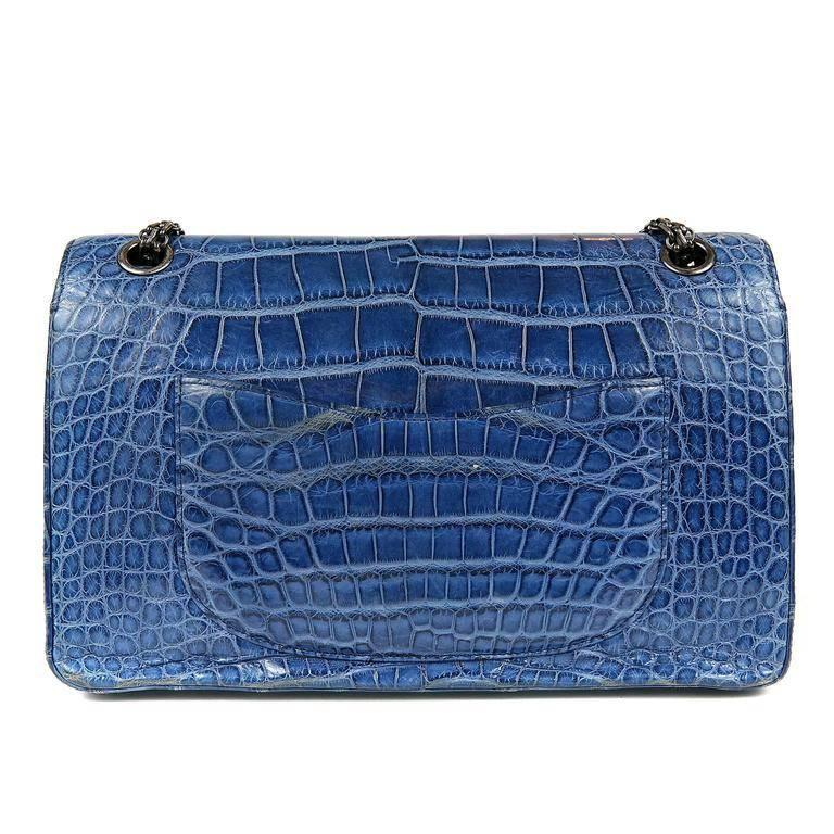 Chanel Blue Sapphire Crocodile 2.55- MINT Extremely rare in the exotic versions, this strikingly beautiful piece is a must have for any collector. Vibrant blue sapphire crocodile skin double flap is paired with edgy ruthenium hardware. Mademoiselle