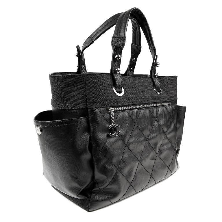 Chanel Black Coated Canvas Biarritz XL Tote- MINT Condition Sturdy and durable, it is a great unisex piece with multiple uses. Weather friendly coated canvas is stitched in signature Chanel diamond pattern. Front pocket has silver interlocking CC