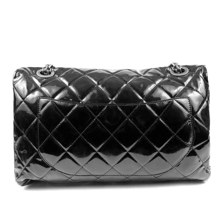 Chanel Black Patent Leather XXL Reissue Bag- PRISTINE It is particularly rare in the oversized silhouette with ruthenium hardware. Glossy black patent leather is quilted in signature Chanel diamond pattern. Ruthenium mademoiselle twist lock secures