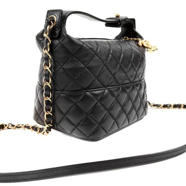 Chanel Black Leather Crossbody- Pristine Condition The versatile small bag easily transitions from day to evening. Black leather is quilted in signature Chanel diamond pattern. Zippered top has large gold interlocking CC pull. Black fabric interior.