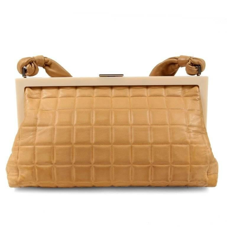 Chanel Beige Chocolate Bar Framed Bag- EXCELLENT PLUS  Perfect for dinner or traveling light, this neutral piece is certain to become a favorite. Beige leather is square quilted with an ivory resin framed top. Brushed silver CC clasp and beige
