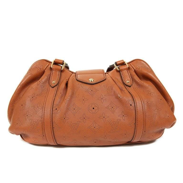 This authentic Louis Vuitton Cognac Mahina Leather Lunar PM is brand new. A fantastic find, the Lunar is stylish and spacious. It is easily carried every day in year-round neutral Cognac. Warm cognac grainy leather is subtly perforated with the