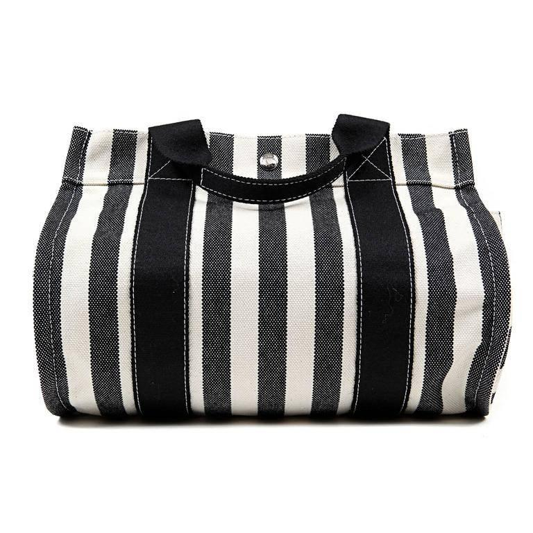 Hermes Black and White Striped Canvas Tote- PRISTINE The cheerful summertime carryall is accompanied by a coordinating black canvas case. Black and cream striped canvas tote is carried in hand or at the elbow by double handles. Rounded bottom