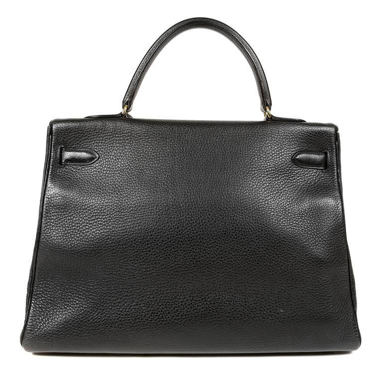 Hermes BLACK Togo 35 cm Kelly Bag - EXCELLENT condition Hermes bags are considered the ultimate luxury item worldwide. Each piece is handcrafted with waitlists that can exceed a year or more. The ladylike Kelly is classic and refined, especially in