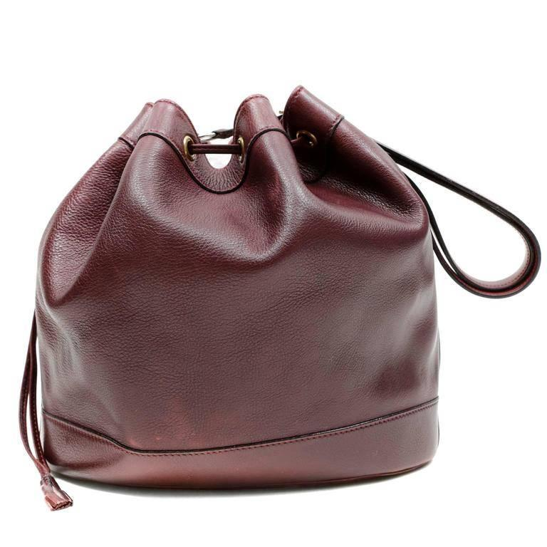 Hermes Bordeaux Leather Vintage Market Bag- EXCELLENT The classic silhouette is a drawstring bucket bag; perfect for every day enjoyment. Deep Bordeaux textured leather bucket bag holds everything easily. Leather drawstring opening, unlined interior