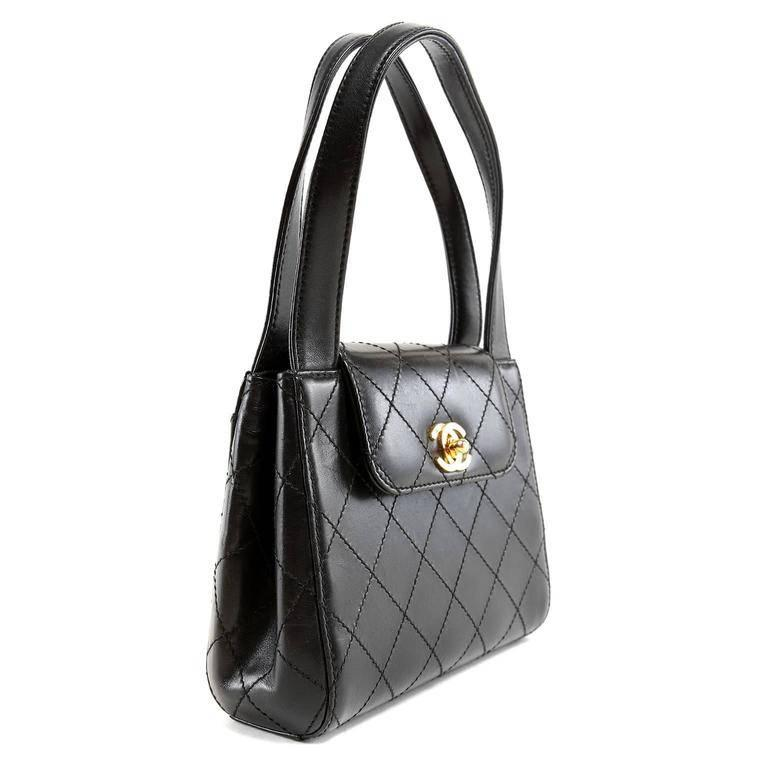 Chanel Black Leather Mini Bag- MINT condition!! Rarely carried and carefully stored. The exquisite piece has a truly timeless quality that is certain to make it a treasured favorite. Black leather is topstitched in signature Chanel diamond pattern.
