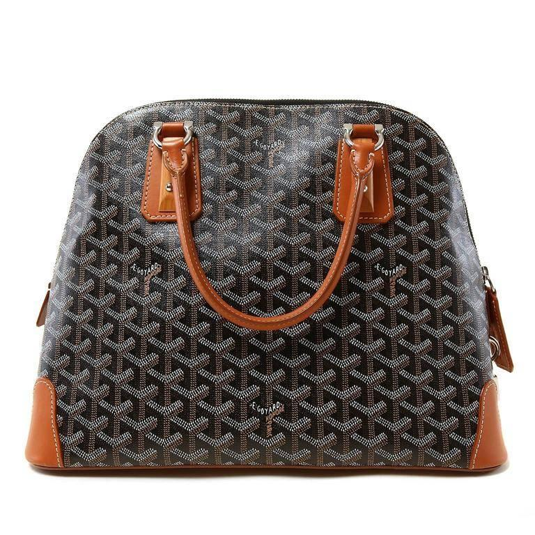 Goyard Black Vendome Bag- RARE! In Pristine Condition Unique design elements make this collectible piece very striking. Black chevron Goyard monogram canvas domes satchel is accented with warm cognac brown leather and wooden trim pieces. Silver tone