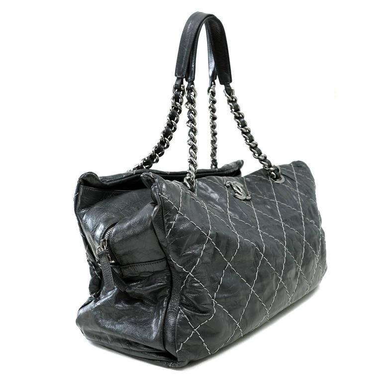 Chanel Grey Contrast Stitched Leather XXL Day Bag- Pristine Versatile and chic, this very roomy tote is ready for anything. Dark grey distressed leather is top stitched in signature Chanel diamond pattern with contrasting thread. A central zippered